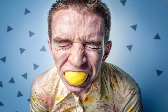 man chewing lemon