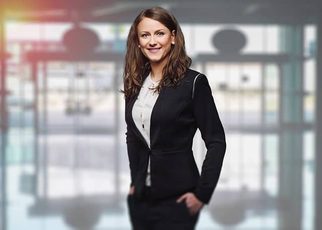 woman smiling in office